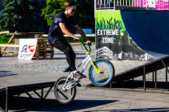 Extreme BMX rider in helmet in skatepark on competition Royalty Free Stock Images
