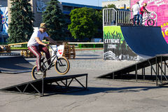 Extreme BMX rider in helmet in skatepark on competition Royalty Free Stock Photography