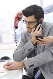 Extreme busy businessman Stock Image