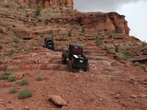 Extreme cliff-climbing with vehicles in the desert stock video footage