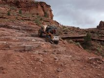 Extreme cliff-climbing with vehicles in the desert stock footage