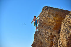 Extreme Climber Climbs On A Rock Royalty Free Stock Image
