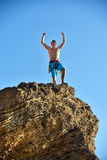 Extreme Climber Raising Hands Stock Image