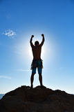 Extreme Climber Raising Hands Royalty Free Stock Images