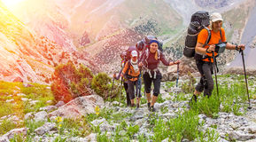 Extreme climbers scrambling up Stock Photos