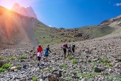 Extreme climbers scrambling up Royalty Free Stock Photo