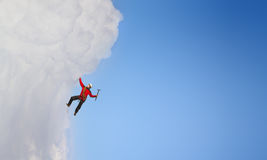 Extreme climbing is his adrenaline . Mixed media Royalty Free Stock Photos
