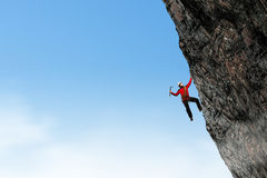 Extreme climbing is his adrenaline . Mixed media Royalty Free Stock Photo