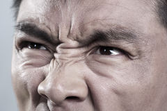 Extreme Close up on angry mans face Royalty Free Stock Photos