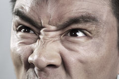 Extreme Close up on angry mans face Royalty Free Stock Images