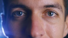 Extreme close up beautiful eyes of young handsome man. Facial expressions. stock video