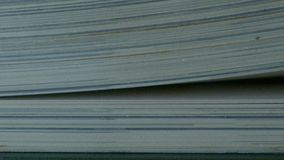 Book with turning pages. Extreme close-up of a book pages in turning action stock footage