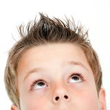 Extreme close up of boy looking up. Stock Images