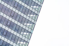Extreme close up building windows texture. Low angle view of mod. Ern commercial office building with vertical windows, architectural exterior against white sky Stock Image