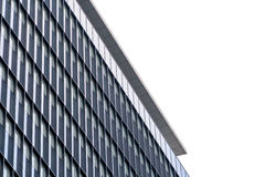 Extreme close up building windows texture. Low angle view of mod. Ern commercial office building with vertical windows, architectural exterior against white sky Royalty Free Stock Images