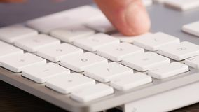 Extreme close -up businessman typing keypad stock footage
