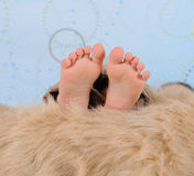 Extreme close-up of child's feet  furry blanket Royalty Free Stock Photos