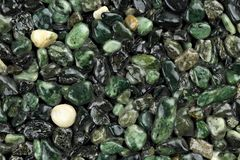 Extreme close up of dark green coloured natural stone carpet. Different shades and tints of green. Decorative stone coating. Slip resistant floor finish royalty free stock photo