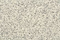 Extreme close up of decorative quartz sand epoxy floor or wall coating with different shades of grey, white and black coloured. Particles royalty free stock photos