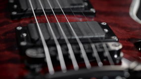 Extreme close-up of an electric guitar. stock video footage