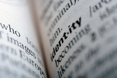 Extreme close up of english dictionary page with word id Stock Images