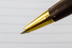 Extreme close up of gold pen Stock Image
