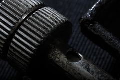 Extreme close up of iron sheave. Details stock photography