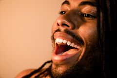 Very happy dreadlocks. Extreme close up of laughing man with dreadlocks stock images