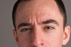 Caucasian Male Headshot - Extreme Closeup. An extreme close up male head shot of a Caucasian man showing his face from below the nose to the top of his head Royalty Free Stock Photography