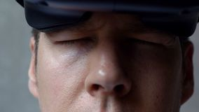 Extreme Close Up of a Man`s Tired Eyes After a Virtual Reality Session stock footage