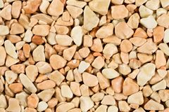 Extreme close up natural stone carpet, beige and cream coloured in different shades and tints of beige. Decorative stone coating. Slip resistant floor finish royalty free stock photo