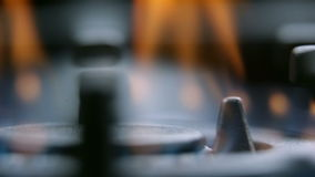 Extreme close up panning on gas cooker fire. Close up shots of kitchen activities while turning on and off fire on gas cooker cooktop stock footage