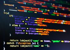Extreme close-up of php code on the dark background. Extreme close-up of colorful php code on the dark background stock photography
