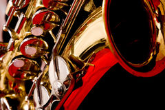 Extreme close up of Saxaphone. Close up of a Saxophone against a red background royalty free stock images