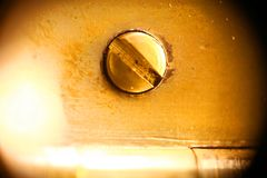 Extreme close up shot brass in brass wall royalty free stock photography