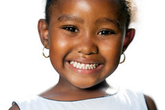 Extreme close up of small african girl showing teeth.T Stock Image