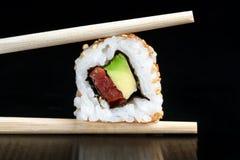 Extreme close up of Tuna and avocado uramaki. Royalty Free Stock Photography