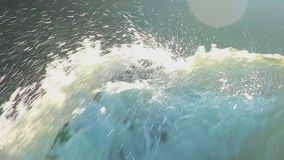 Extreme close-up of turbulent water splashing against rocks. Stock footage stock video footage
