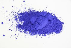 Ultramarine pigment isolated over white. Extreme close up of ultramarine deep blue pigment isolated over white background Royalty Free Stock Photo