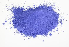 Ultramarine pigment isolated over white. Extreme close up of ultramarine pigment isolated over white background Stock Photography