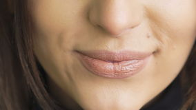 Extreme close up of woman licking and bitting lips. Slowly stock footage