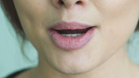 Extreme close up of woman licking and bitting lips. Slowly stock video footage