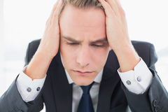 Extreme Close up of a worried businessman at office Stock Images