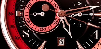 Extreme close up of wrist watch face/ Mechanical background with black red and pink.  Stock Photography