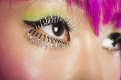 Extreme close-up of young funky woman's face with false eyelashes Royalty Free Stock Photo
