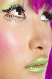 Extreme close-up of young funky woman's face with false eyelashes and green lipstick Royalty Free Stock Photos