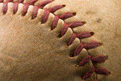 Extreme closeup of a Baseball. Extreme closeup of the red stitches of an old baseball Royalty Free Stock Photo