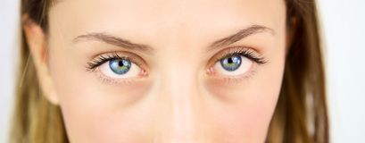 Extreme closeup of beautiful blue eyes of blond girl Royalty Free Stock Image