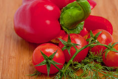 Extreme closeup on branch of cherry tomatoes Stock Photo