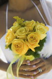 Extreme Closeup Of Bride Holding Yellow Roses Royalty Free Stock Images